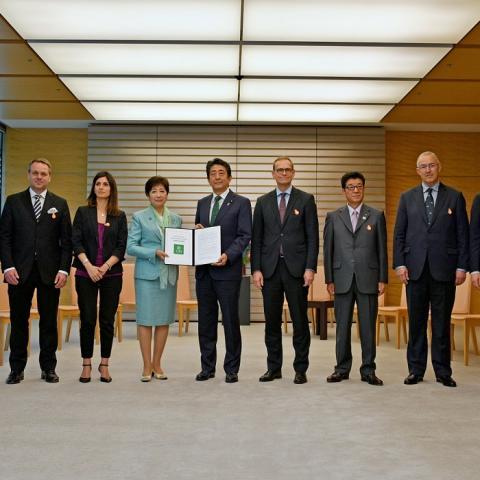 Mayors and Governor Koike of Tokyo handing the U20 joint position to the Japanese Prime Minister